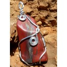 Red Jasper Pendant set in silver coloured wire (€ 3.50)